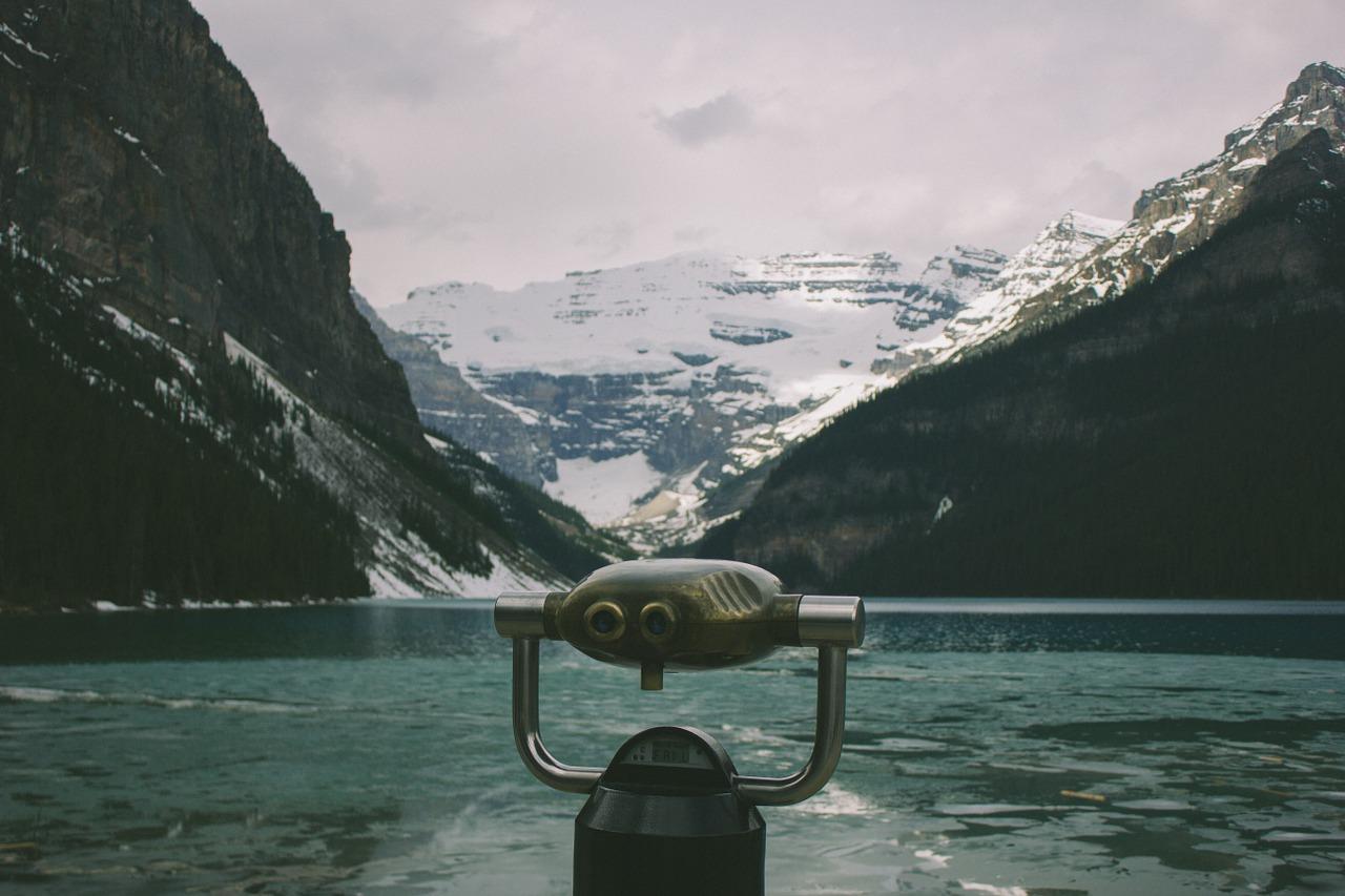 binoculars looking over lake